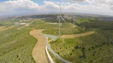 Modern wind turbines generating alternative energy for eco-friendly enterprise Live Action