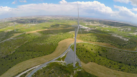 Wind farm near factory, lush green landscape untouched by technical progress Footage