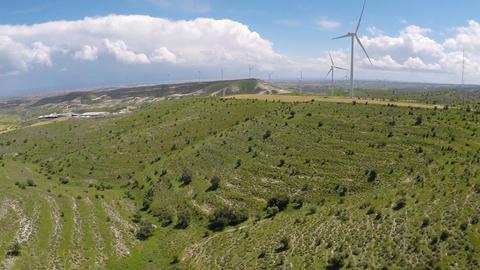 Modern wind turbines surrounded by beautiful nature, green energy generation Footage