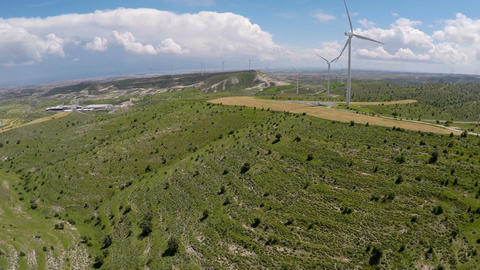 Ecology minded industrial area with plant and wind farm, renewable energy source Live Action