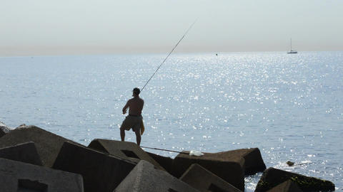 Fisherman Throws Bait into the Sea Footage