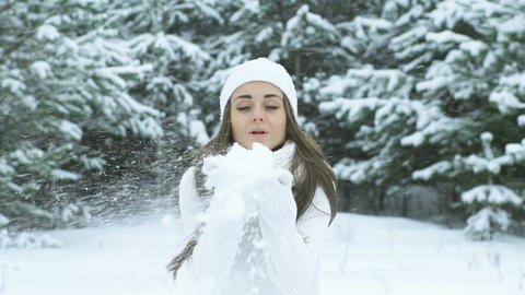Winter Woman Blowing Snow Footage