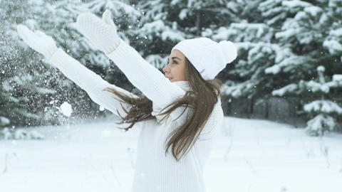 Beautiful Woman Blowing Snow Footage