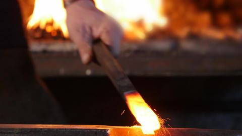 Blacksmith Forging Iron on an Anvil ビデオ