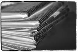 Close up shot folded newspapers film negative. Copyspace Photo