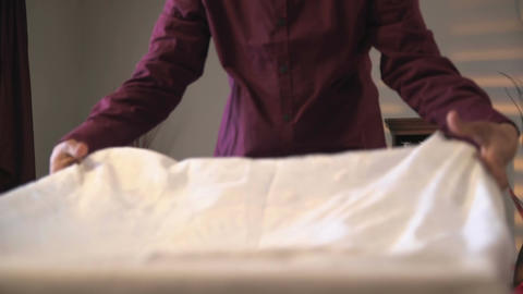 Man puts a white cloth on the table Stock Video Footage