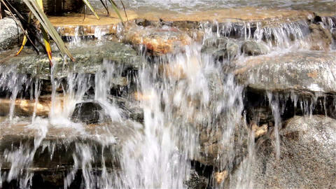 Waterfall flowing from the rocks Footage