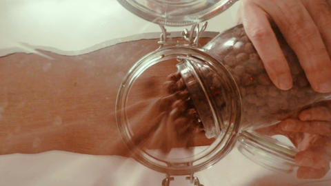 Pouring cereal into a glass jar - View from inside the jar Live Action