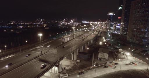 Aerial night highway bridge passing cars Footage