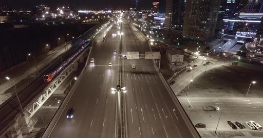 Aerial night highway bridge passing cars