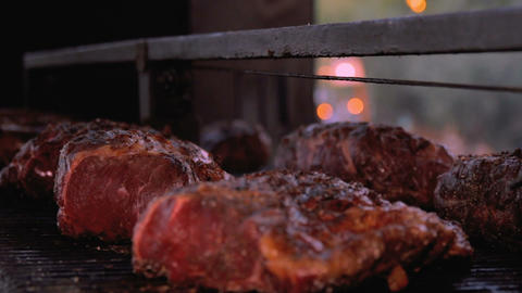 Beef meat on the grill barbecue - Panning shot Footage