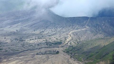 Landscape with Pura Luhur Poten hindu temple near Bromo volcano. Java, Indonesia Footage