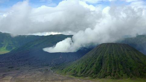 Volcanic eruption against blue sky. Mount Bromo, East Java, Indonesia Footage