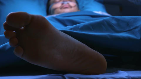 Patient lying in a hospital bed Footage