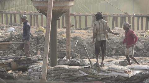 Indian worker supervising piling work done at site Live Action