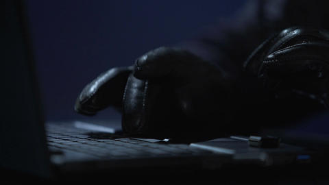 Security hacker connecting USB drive with computer virus to laptop, cybercrime Footage