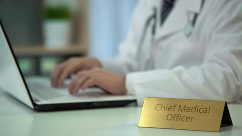Hands of chief medical officer ordering medicaments online, typing on laptop Footage