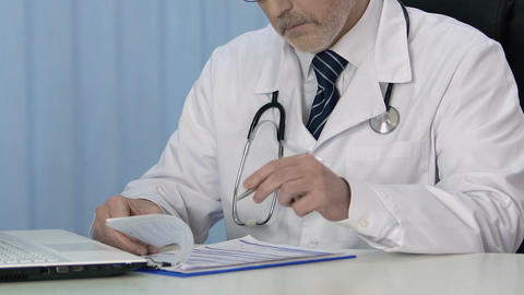 Professional therapist writing prescription for patient, keeping medical records Footage