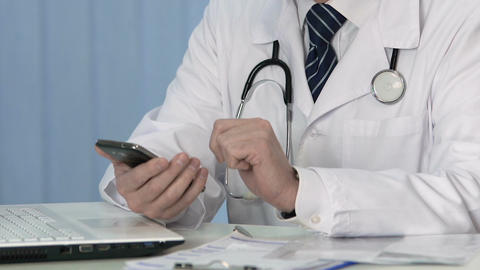 Health professional viewing test results on smartphone, sliding e-documents Footage