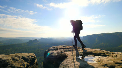 Tourist with medicine crutch above head achieved mountain peak. Hiker with broke Footage