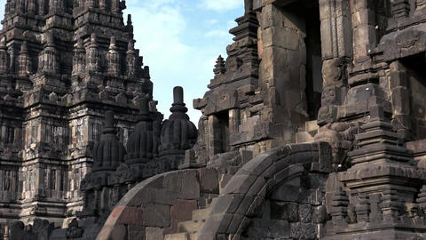 Impressively shrine of ancient Prambanan Hindu temple complex. Java, Indonesia Live Action