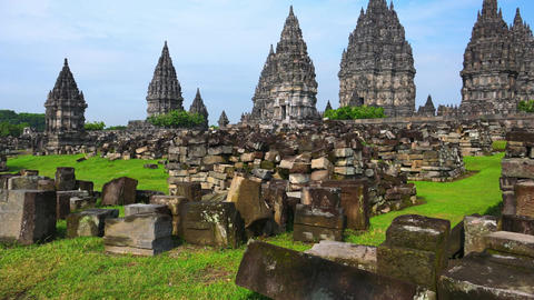 Mystical Prambanan Hindu temple complex with ruins on foreground. Indonesia Footage