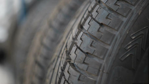 Car tyres at warehouse in tire store