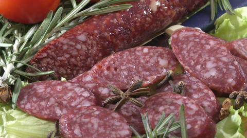 Slice sausage and fresh herbs Footage