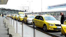 Václav Havel Airport Prague - entrance to the airport with taxi cars parked out Footage
