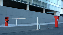 Gate On The Road In Front Of Building stock footage