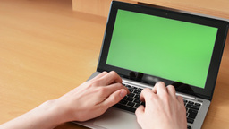 notebook - green screen - man typing on computer (keyboard) on the table Live Action