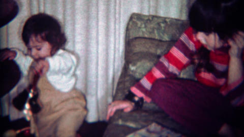 1969: Baby carelessly plays with heavy metal bell Footage