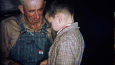 1969: Overall dressed grandpa and boy share a special moment together Footage