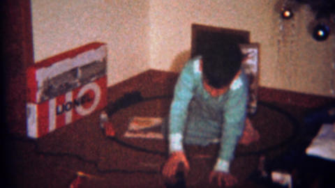 1962: Boy plays with Lionel train set Christmas morning Footage