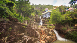 Waterfalls Cascade on Mountain River Green Slopes Houses Footage