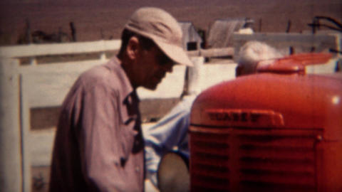 1951: Salesman sells man new red Case brand farm tractor Footage