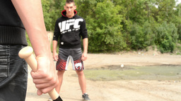 man threatens man with baseball bat - outdoors Footage