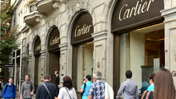 Luxury store (exterior) with people - Cartier. Parisian Street in Prague Footage