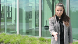 Business women gives a hand to handshake before business building Footage