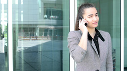 Business woman phone before bussines building Footage