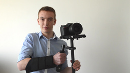 man with professional camera (steadicam) Footage