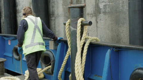 Female ferry worker with ropes Footage