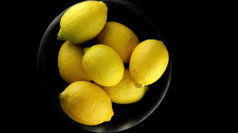 Whole lemons on black Footage
