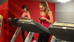Young women doing sports, running on machines in fitness, gym. Workout. Woman li Footage