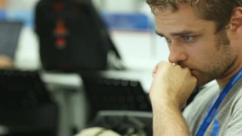 Camera Shows Man Working on Laptop at Number Twenty Workplace GIF