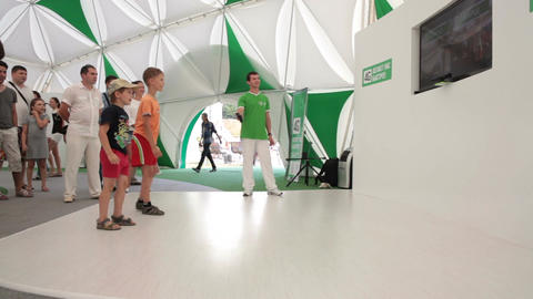 Boys Play in Virtual Sport Game at Special High-tech Stand Footage