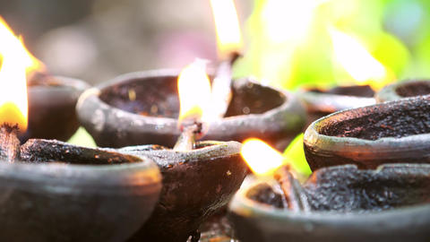 Burning oil lamps as traditional offering in buddhist and hindu temples Footage