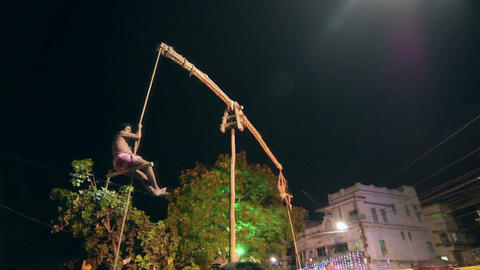 Hindu devotees hanging in air for Charhak festival, for welcoming Bengali new ye Filmmaterial