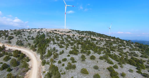 Two spinning Wind Turbines Aerial Footage Footage