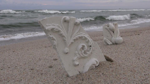 Two plaster pieces on the beach Footage